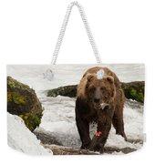 Brown Bear Eating Salmon Tail Beside Rocks Weekender Tote Bag