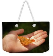 Butterfly On A Childs Hand Weekender Tote Bag