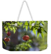 Red Papery Covering Over Its Fruit Weekender Tote Bag
