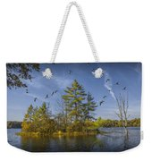 Canada Geese Flying By A Small Island On Hall Lake Weekender Tote Bag