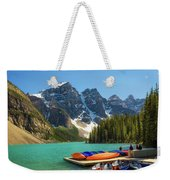 Canoes On A Jetty At  Moraine Lake In Banff National Park, Canada Weekender Tote Bag