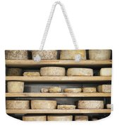 Cheese Wheels On Wooden Shelves In The Cheese Store Weekender Tote Bag