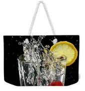 Cherries Splashing Into Sparkling Water Glass With Lemon Slice O Weekender Tote Bag