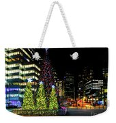 Christmas Tree On New Year's Eve In The Street Of A Big City Weekender Tote Bag