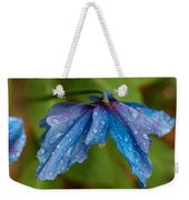Close-up Of Raindrops On Blue Flowers Weekender Tote Bag