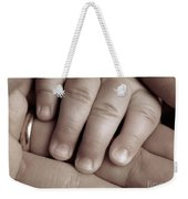 Closeup Of A Baby's Hand Weekender Tote Bag