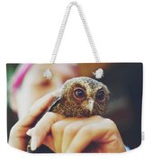 Closeup Portrait Of A Girl Holding And Tending A Small Baby Owl In Her Hands Weekender Tote Bag