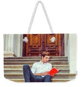 College Student Reading Red Book, Sitting On Stairs, Relaxing Ou Weekender Tote Bag