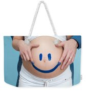 Couple Painting A Smiley On A Pregnant Woman's Belly Weekender Tote Bag