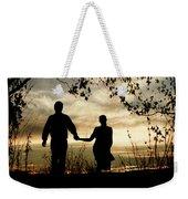 Couple Walking At Sunset Weekender Tote Bag by Clayton Bastiani
