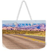 descending into Monument Valley at Utah  Arizona border  Weekender Tote Bag