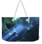 Diver Silhouetted In Sunrays Of Cenote Weekender Tote Bag