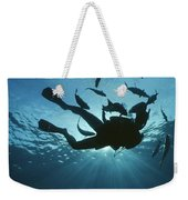 Fish Swim Around A Diver In The Cayman Weekender Tote Bag