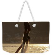 Flyboarder And Water Droplets Backlit At Sunset Weekender Tote Bag