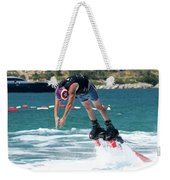 Flyboarder Bending Over To Dive Into Water Weekender Tote Bag
