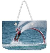 Flyboarder In Red Entering Water With Spray Weekender Tote Bag