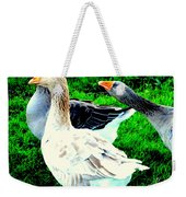 A Couple Of Friendly Geese And One Goose Ready For A Fight  Weekender Tote Bag by Hilde Widerberg