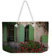 Green Windows And Red Geranium Flowers Weekender Tote Bag by Yair Karelic