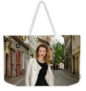 Grinning Attractive Woman Standing On Cobblestone Street Of Uppe Weekender Tote Bag
