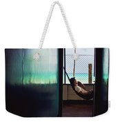 Guy With The Hat Lying In A Hammock On The Porch Of The Old House And Relaxing By The Caribbean Sea Weekender Tote Bag