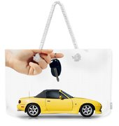 Hand Holding Key To Yellow Sports Car Weekender Tote Bag