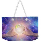Hands With A Glowing Earth Weekender Tote Bag