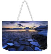 Ice Flakes Drifting Against The Sunset Weekender Tote Bag by Arild Heitmann