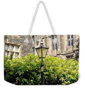 Lamppost In Front Of Green Bushes And Old Walls. Weekender Tote Bag