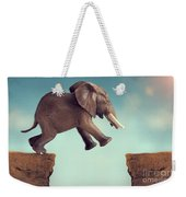 Leap Of Faith Concept Elephant Jumping Across A Crevasse Weekender Tote Bag