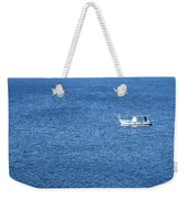 Lonely Fishing Boat Sailing On A Calm Blue Sea Weekender Tote Bag
