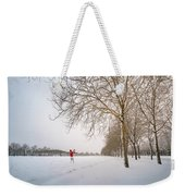 Man In Red Taking Picture Of Snowy Field And Trees Weekender Tote Bag