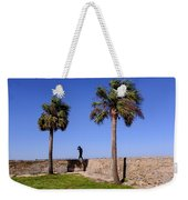 Man With A Hat On The Wall With Palm Trees In Saint Augustine Fl Weekender Tote Bag