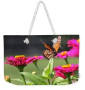 Monarch Approaching Zinnia Weekender Tote Bag