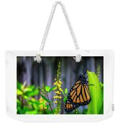 Monarch Butterfly Poised On Green Stem Among Yellow Flowers Weekender Tote Bag