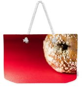 Old Rotting Apple With Fruit-rot On Red Background Weekender Tote Bag