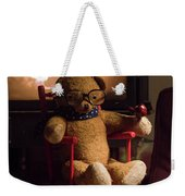 Old Teddy Bear Sitting Front Of The Fireplace In A Cold Night Weekender Tote Bag