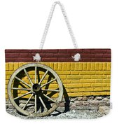 Old Wooden Wheel Against A Wall Weekender Tote Bag