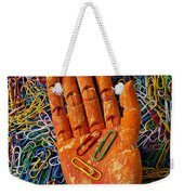 Orange Wooden Hand Holding Paperclips Weekender Tote Bag