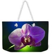 Orchid Flower On Black Background Weekender Tote Bag