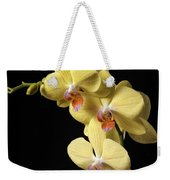 Orchid Set Against Black. Weekender Tote Bag