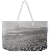 Orville Making Right Turn Showing Warping Of Wings Hill Visible In Front Of Him Kitty Hawk North Car Weekender Tote Bag