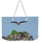Osprey Flying Over A Bird's Nest Weekender Tote Bag