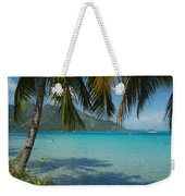 Palm Trees Cast A Shadow In Blue Water Weekender Tote Bag
