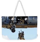 Pararescuemen Are Hoisted Into An Hh-60 Weekender Tote Bag