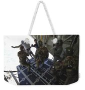 Paratroopers Jump From A C-130 Hercules Weekender Tote Bag by Andrew Chittock