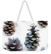 Pine Cones Looking Like Christmas Trees On White Snowy Backgroun Weekender Tote Bag