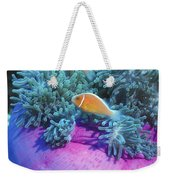 Pink Anemonefish Protect Their Purple Weekender Tote Bag by Michael Wood