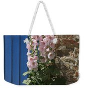 Pink Hollyhocks Growing From A Crack In The Pavement Weekender Tote Bag