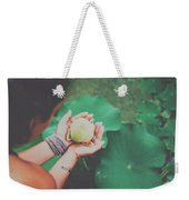 Portrait Of A Girl Holding Gently A Lotus Flower In Her Hands Weekender Tote Bag