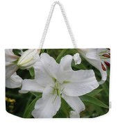Pretty White Lilies Blooming In A Garden Weekender Tote Bag